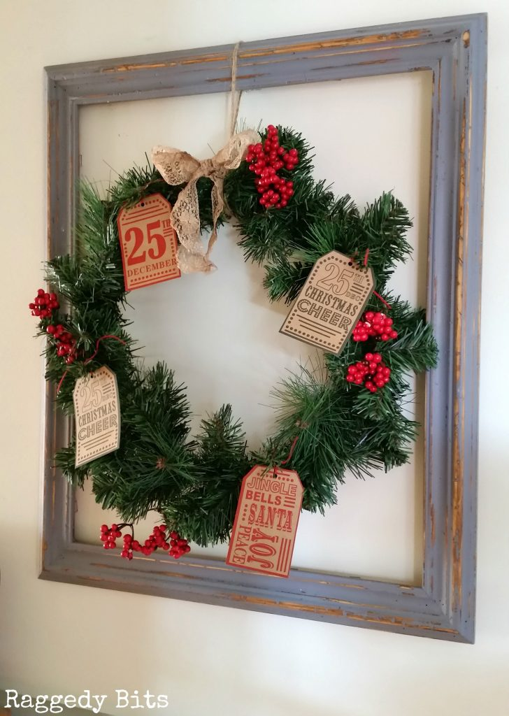 Make a Super Quick and Easy Vintage Wreath Frame using some vintage tags and some Christmas Berries | www.raggedy-bits.com