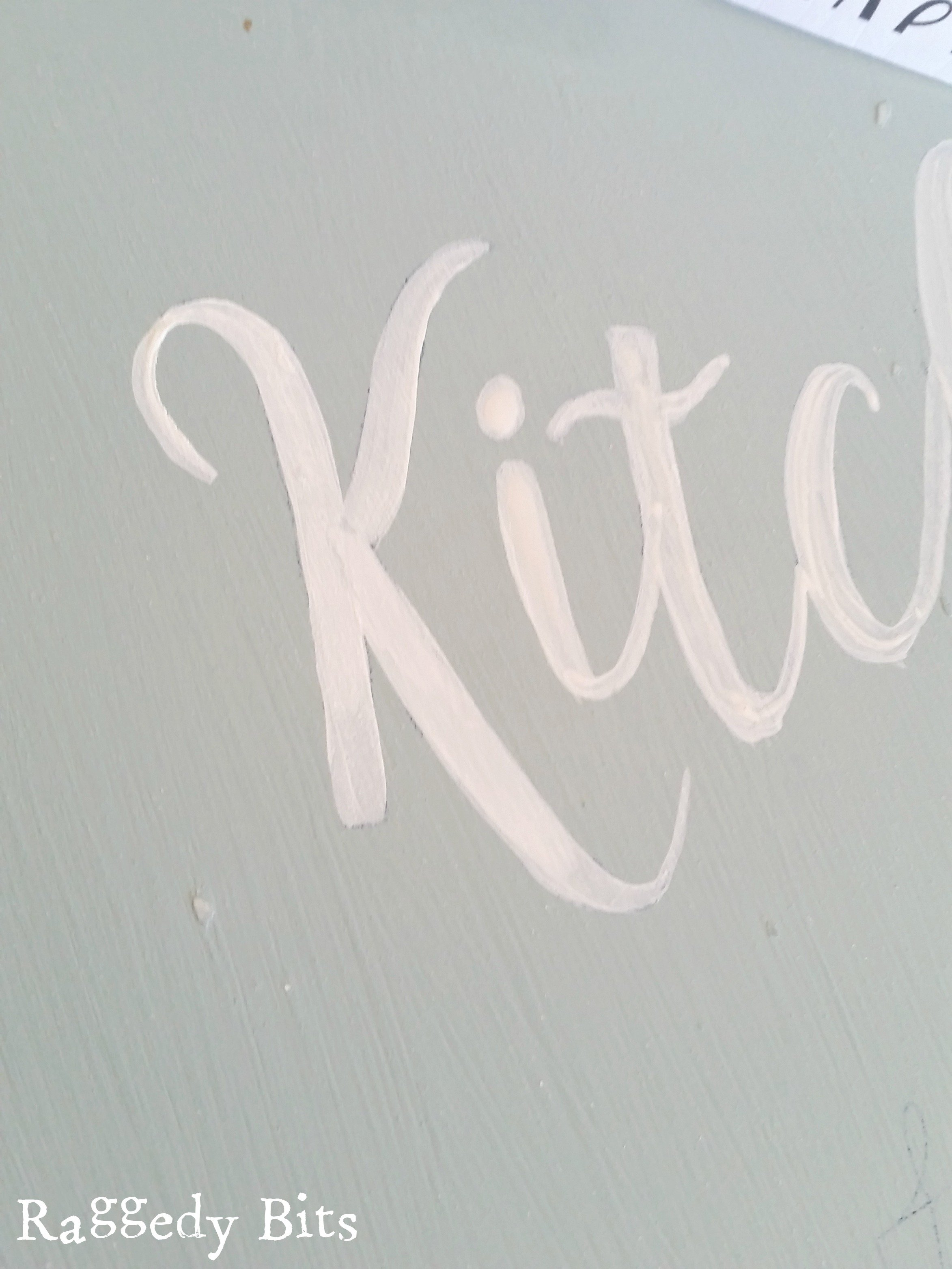 Using transfer paper and an old beveled edge mirror I turned it into a DIY Mirror Kitchen Sign. Full tutorial | www.raggedy-bits.com