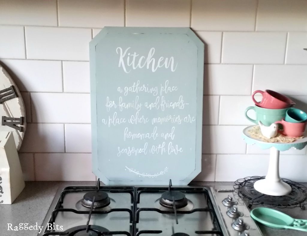 After deciding not to throw out this old beveled edged mirror, inspiration struck to make a DIY Mirror Kitchen Sign for my kitchen | www.raggedy-bits.com