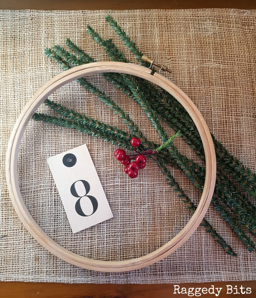 Make a Simple Farmhouse Embroidery Hoop Wreath using Pine Stems and Christmas Berries | www.raggedy-bits.com