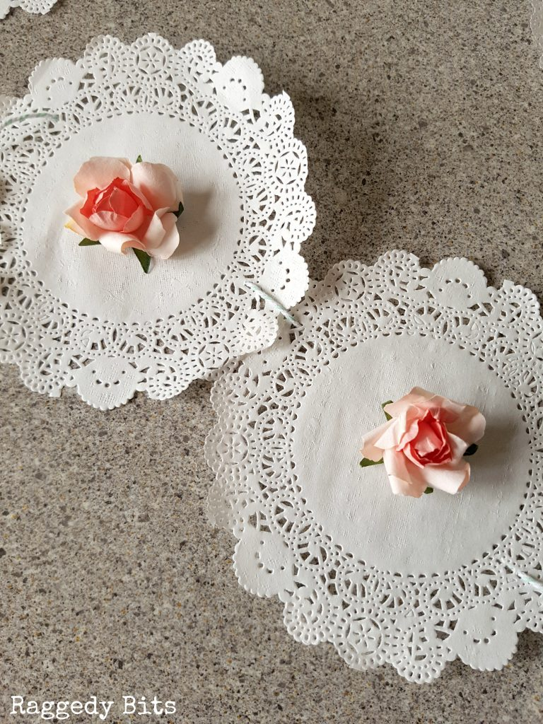 Make a 10 Minute DIY Farmhouse Paper Rose Doily Garland to add some farmhouse charm to your Valentine, wedding or any romantic occasion | Full tutorial | www.raggedy-bits.com