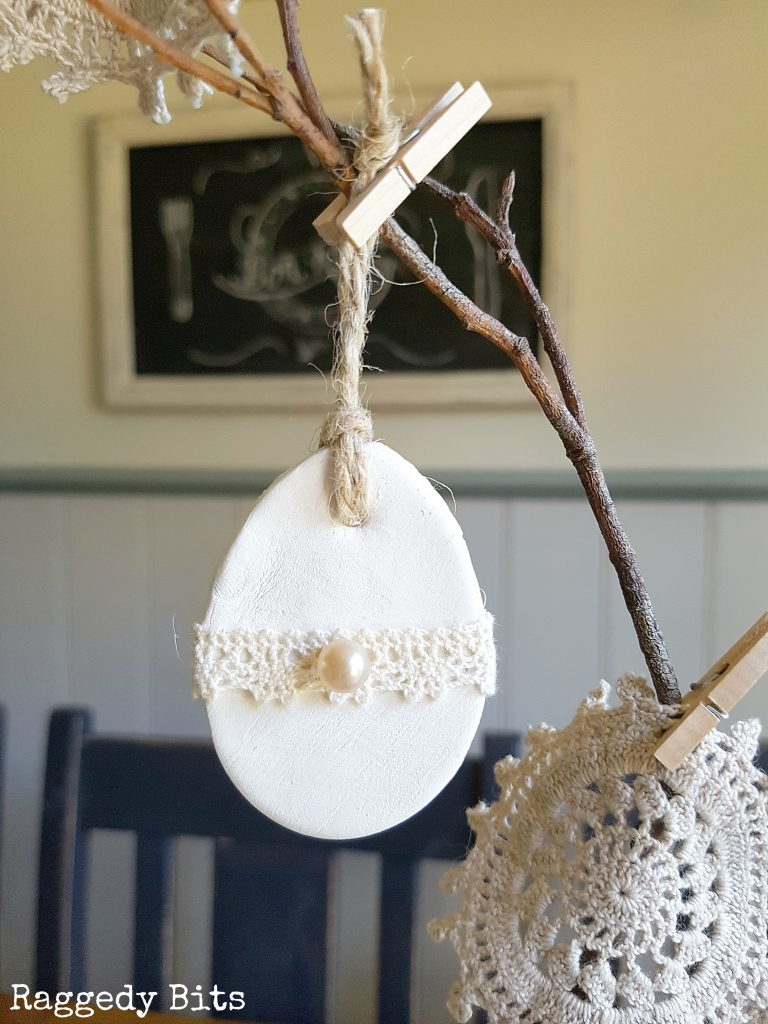 It has become a bit of a tradition in our house for me to decorate our twig tree according to the occasion/season. So with Easter on its way I'm sharing how to make these cute Clay Bunny and Egg Twig Tree Decorations to add some fun Vintage Farmhouse Charm to your decorating | Full tutorial | www.raggedy-bits.com
