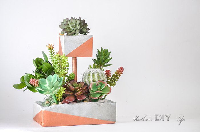 Tiered DIY Concrete Planter with Copper Pipes which is a feature from Waste Not Wednesday-48 by Anika's DIY Life | www.raggedy-bits.com