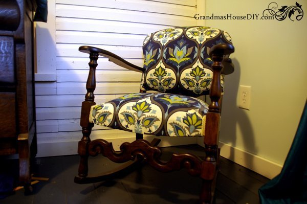 An old Rocking Chair gets a complete refinish with stain and fabric which is a feature from Waste Not Wednesday-51 by Grandma's House DIY | www.raggedy-bits.com