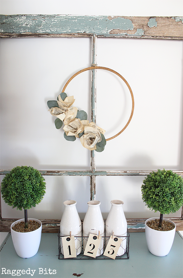 Sharing a fun Easy Farmhouse Book Page Embroidery Hoop Wreath to add some neutral charm to your home | www.raggedy-bits.com