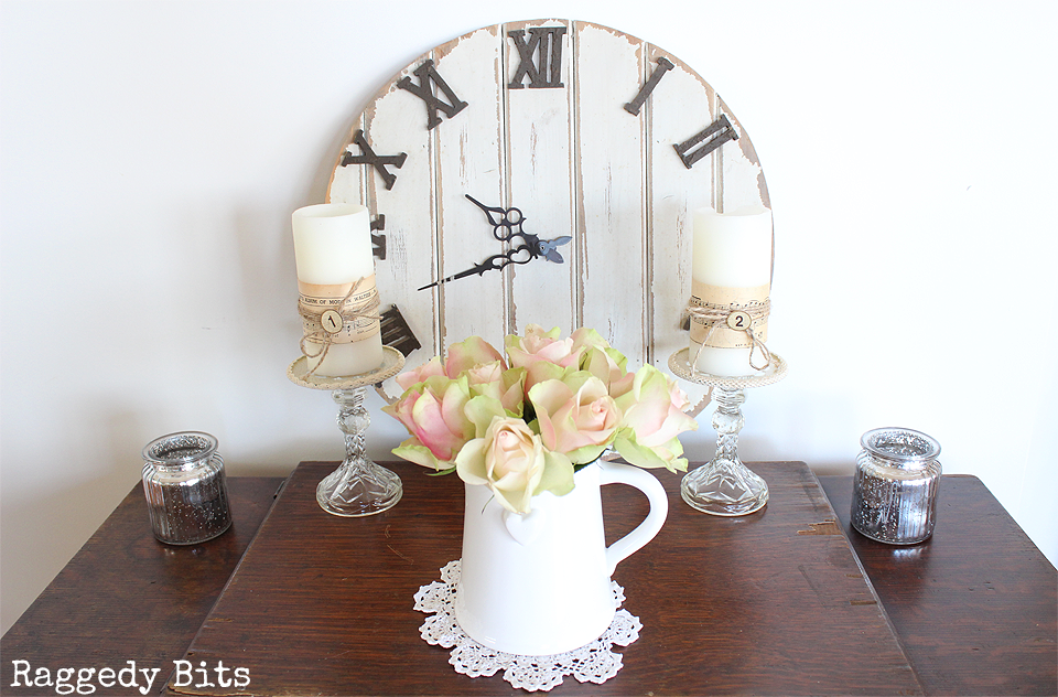 Sharing a fun Simple Vintage Farmhouse Vignette to pack a punch to any corner of your home. Won't cost an arm and a leg and will add some sweet farmhouse charm to your home | www.raggedy-bits.com
