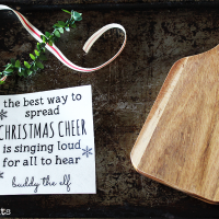 Day 2 of the 12 Days of Christmas Blog Hop and it's all about your favourite Christmas Movie. Sharing a Farmhouse Christmas Wooden Paddle inspired by the movie Elf | www.raggedy-bits.com | #farmhouse #christmas #DIY #12DaysOfChristmas #wooden #paddle