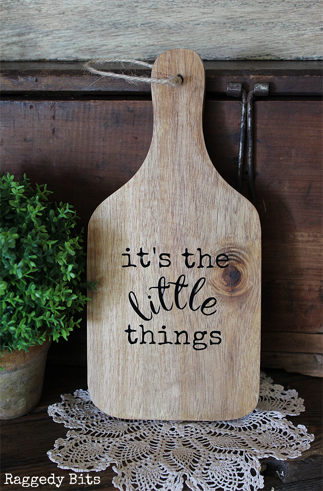 Greet each day with this cheery Rustic Wooden Paddle that reads It's the Little Things. Click on the picture to find out more details | www.raggedy-bits.com | #raggedybits #wooden #paddle #farmhouse #rustic #homedecor #shop