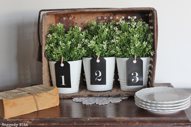 Using some plain black tags see how to make Simple Farmhouse Number Tags to use decorating your home | www.raggedy-bits.com | #tags #number #farmhouse #raggedybits #homedecor