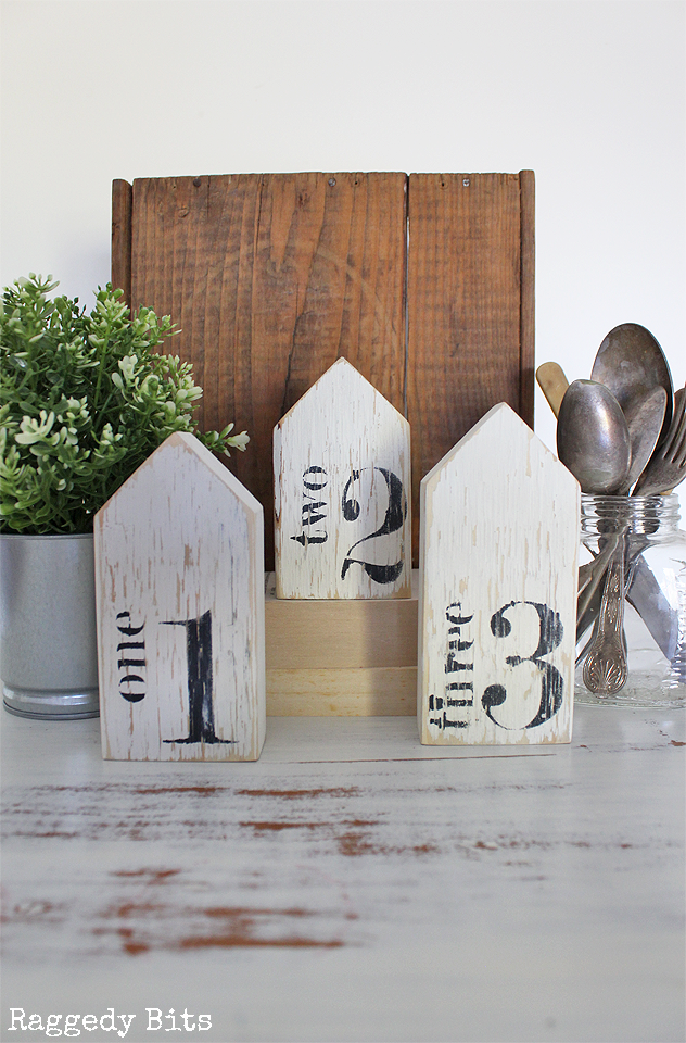 Add some farmhouse charm to your home with these sweet set of 3 handpainted Farmhouse Numbered Wooden Houses. Click on the picture to find out more details | www.raggedy-bits.com | #farmhouse #numbered #handpainted #raggedybits #houses #shop
