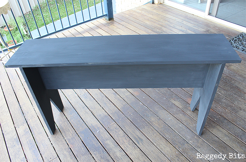 Sharing a fun way on how to make and then paint a Farmhouse Bench to decorate your home with. Using Sweet Pickins Milk Paint - Zinc and Creamy Sealed with a Dark Oil Wax. Full tutorial and supply list | www.raggedy-bits.com | #raggedybits #bench #farmhouse #paint #sweetpickins #milkpaint #DIY #furniture #build #paint