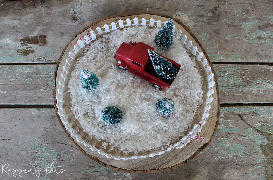 Sharing how to make a simple Red Truck Christmas Bottle Brush Tree Display that you can do in 10 minutes | www.raggedy-bits.com | #raggedybits #redtruck #farmhouse #christmas #trees #bottlebrush #woodslice