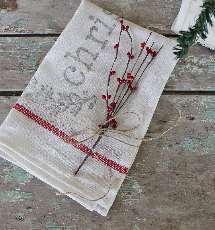 Day 4 of our 12 Days of Christmas Blog Hop 2018 is all about Kids Christmas Craft. Sharing how to make a Farmhouse Christmas Stamped Tea Towel | www.raggedy-bits.com #raggedybits #farmhouse #vintage #christmas #12DaysOfChristmasBlogHop #teatowel #easy #DIY #IOD #stamped
