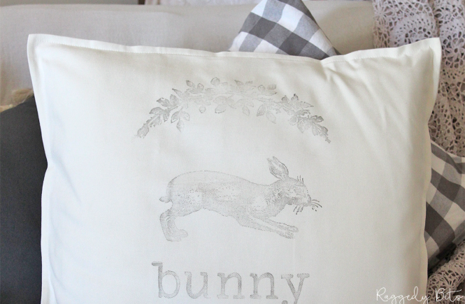A fun way to transform a simple cushion into some fun Farmhouse Easter Decor using IOD Farmhouse Animal and Floral Swag Decor Stamps | How to Make an Easy Farmhouse Easter Bunny Pillow | www.raggedy-bits.com | #raggedybits #DIY #stamped #IOD #cushion #pillow #farmhouse #bunny