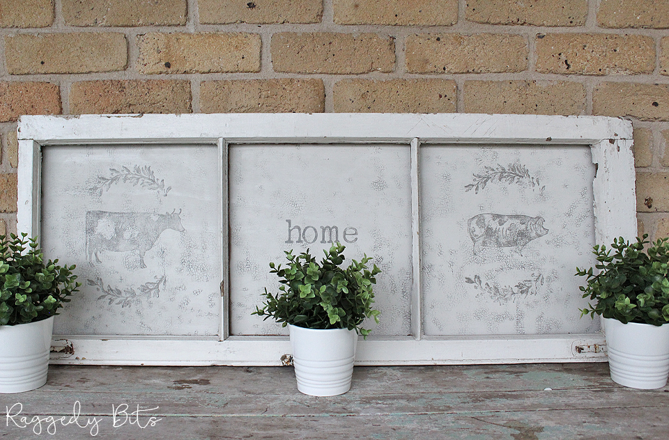 Using an old window along with some Fusion Mineral Paint - Raw Silk and Iron Orchid Designs Decor Stamps you to can make a some fun wall art | How To Give An Old Farmhouse Style Window A Fresh New Look | www.raggedy-bits.com | #raggedybits #farmhouse #homedecor #DIY #fusionmineralpaint #rawsilk #IronOrchidDesigns #repurpose