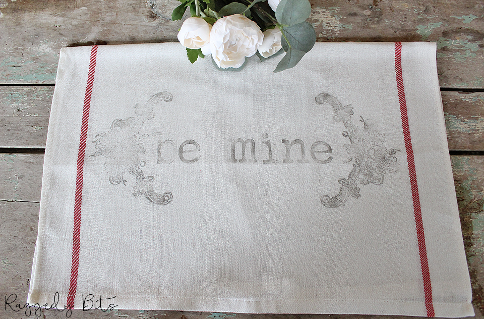 Spread some love this Valentines Day with these hand stamped Ikea Tea Towels using Iron Orchid Designs Decor Stamps | www.raggedy-bits.com | #raggedybits #DIY #valentines #farmhouse #decorstamps