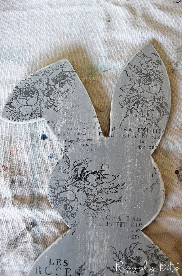 Sharing a fun way to make a Farmhouse Bunny Door Hanger using plywood and Iron Orchid Design Decor Stamps with Miss Mustard Seed Milkpaint | www.raggedy-bits.com | #raggedybits #Bunny #decor #mmsmilkpaint #IODDecorStamps #diy #craft #paint