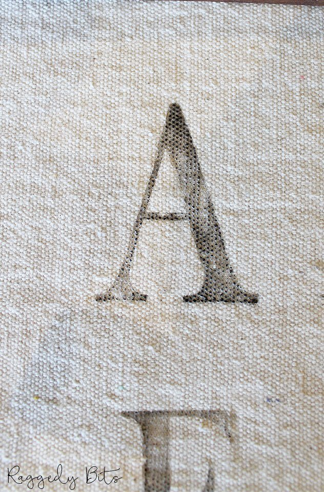 Using some linen or drop cloth and some stamps, you too can make a Vintage Farmhouse Alphabet Wall Hanger | www.raggedy-bits.com | #raggedybits #DIY #farmhouse #vintage #wallhanger #wallart #IODDecorStamps