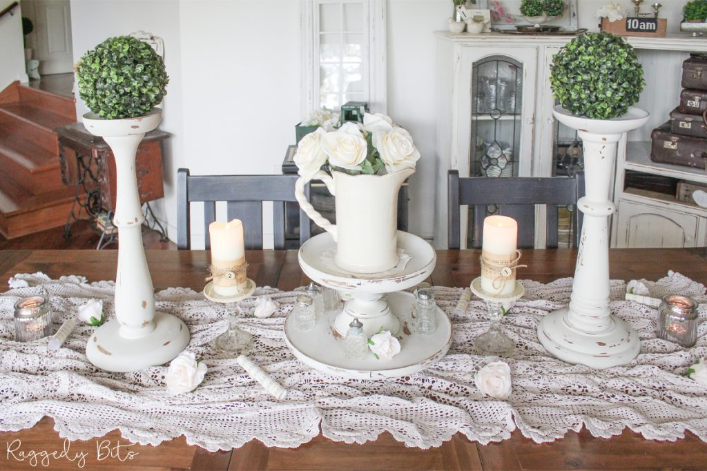 Sharing a fun way on how to use farmhouse thrifted finds as a table centerpiece. You'll be surprised also on how many things you may find around your home that are either dated or about to head to good will that once transformed can give your home a brand new look   www.raggedy-bits.com   #raggedybits #diy #tablescape #farmhouse #vintage #upcycle #repurpose #centerpiece #milkpaint #decorate