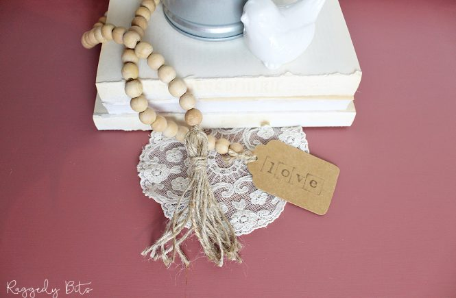 See how easy it is to make an Easy Farmhouse Wooden Bead Garland using jute and wooden beads | www.raggedy-bits.com | #raggedybits #DIY #craft #farmhouse #decorate