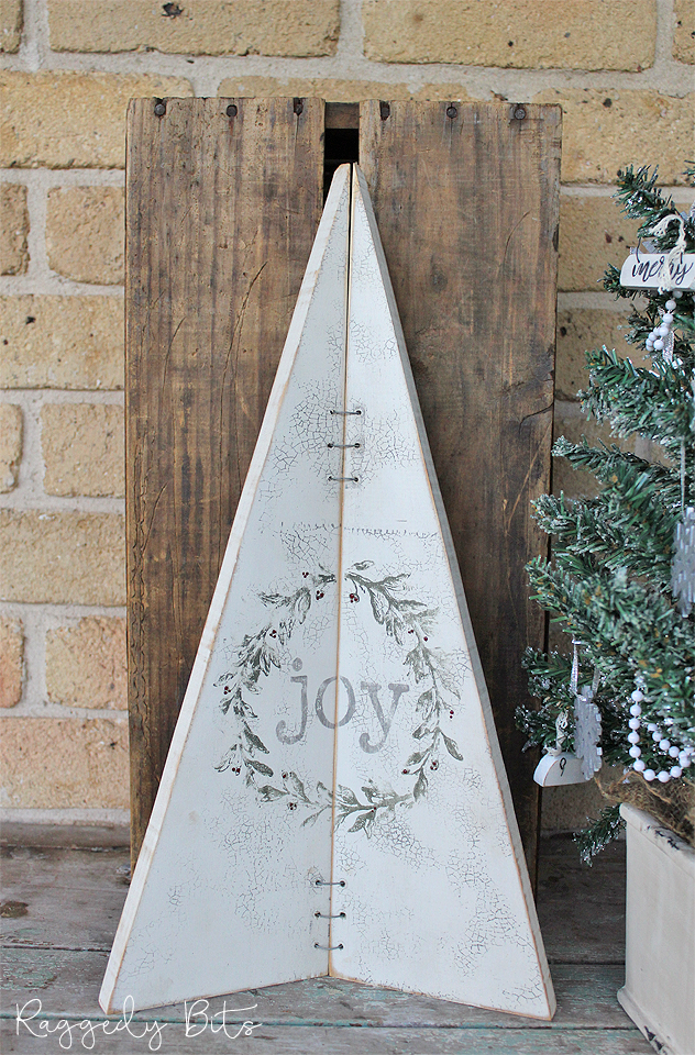 Have some fun learning how to make this Stamped Joy Christmas Tree to decorate with or make as a gift | www.raggedy-bits.com | #raggedybits #christmas #rustic #christmastree #sign #DIY #farmhouse #fusionmineralpaint #workshop