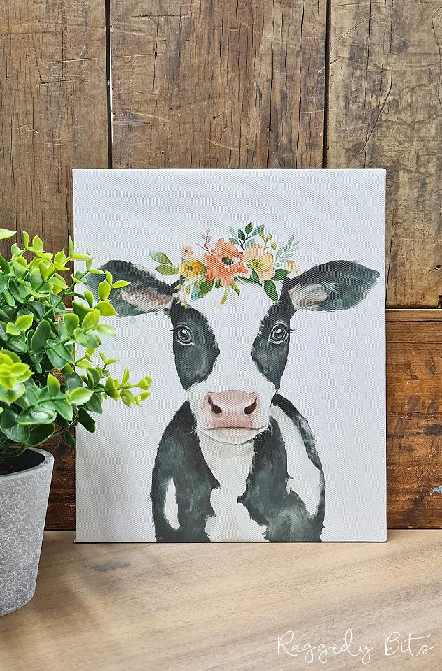 Farmhouse Floral Crown Cow Canvas   www.raggedy-bits.com   #raggedybits #vintage #rustic #faux #cow #flowercrown #homedecor #farmhouse