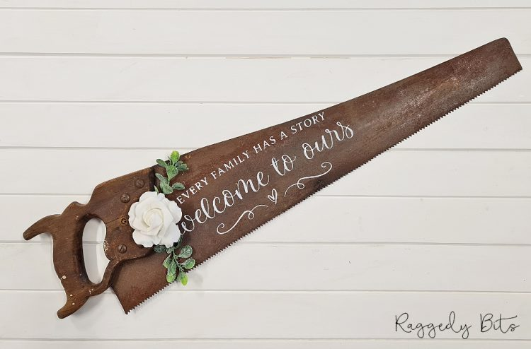 Farmhouse Every Family Welcome to Ours Old Saw Sign | www.raggedy-bits.com #raggedybits #farmhouse #sign #oldsaw #handmade