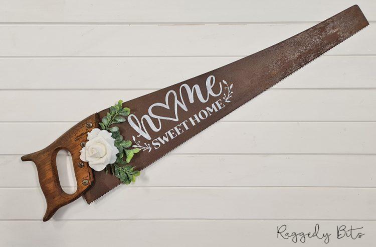 Farmhouse Home Sweet Home Saw Sign | www.raggedy-bits.com #raggedybits #farmhouse #sign #oldsaw #handmade