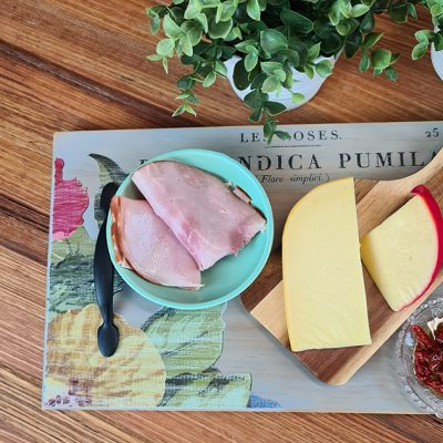 Using a scrap piece of pine timber and some food safe milk pant sharing a fun way on how to make a Vintage Farmhouse Charcuterie Board | www.raggedy-bits.com | #raggedybits #DIY #charcuterie #spmilkpaint #upcycle #repurpose #farmhouse #vintage #decortransfer #iod