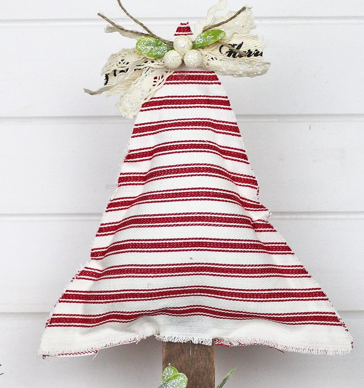 Sharing a super easy now sew Wooden Stand Farmhouse Christmas Tree using scrap wood   www.raggedy-bits.com   #raggedybits #diy #christmas #tree #farmhouse #fabric #nosew